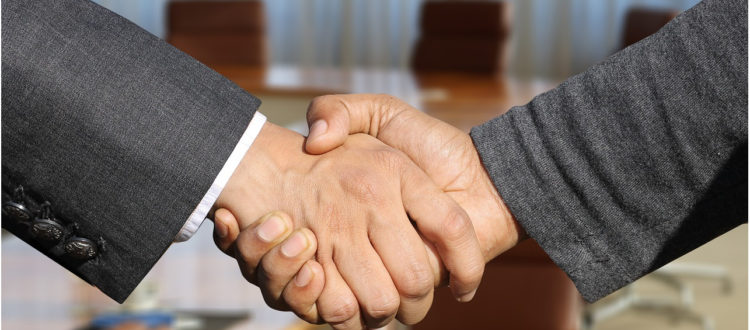 Handshake on successful financing